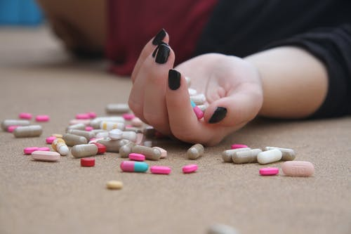 Person Holding Medical Pills