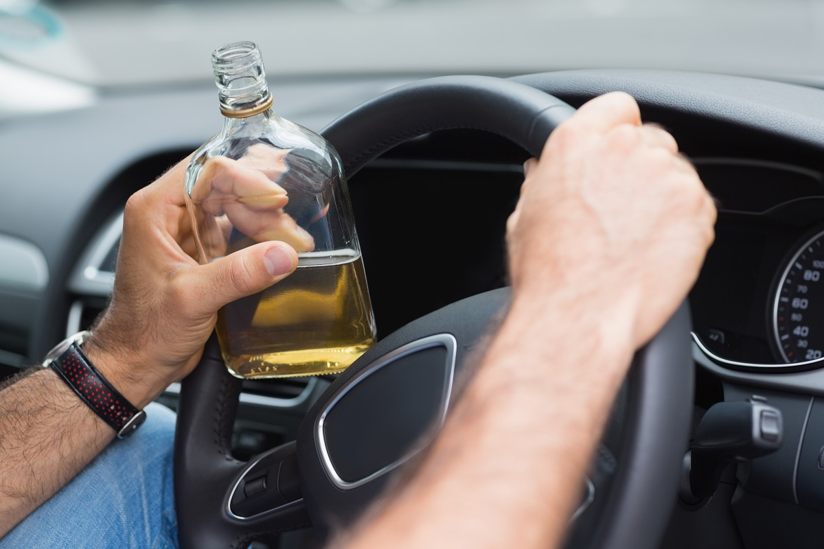Man drinking and driving.jpg