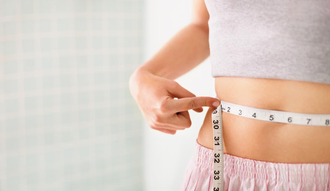 woman-measuring-her-waist