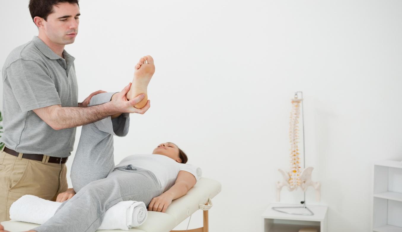 bigstock-Brunette-physiotherapist-manip-36748081.jpg