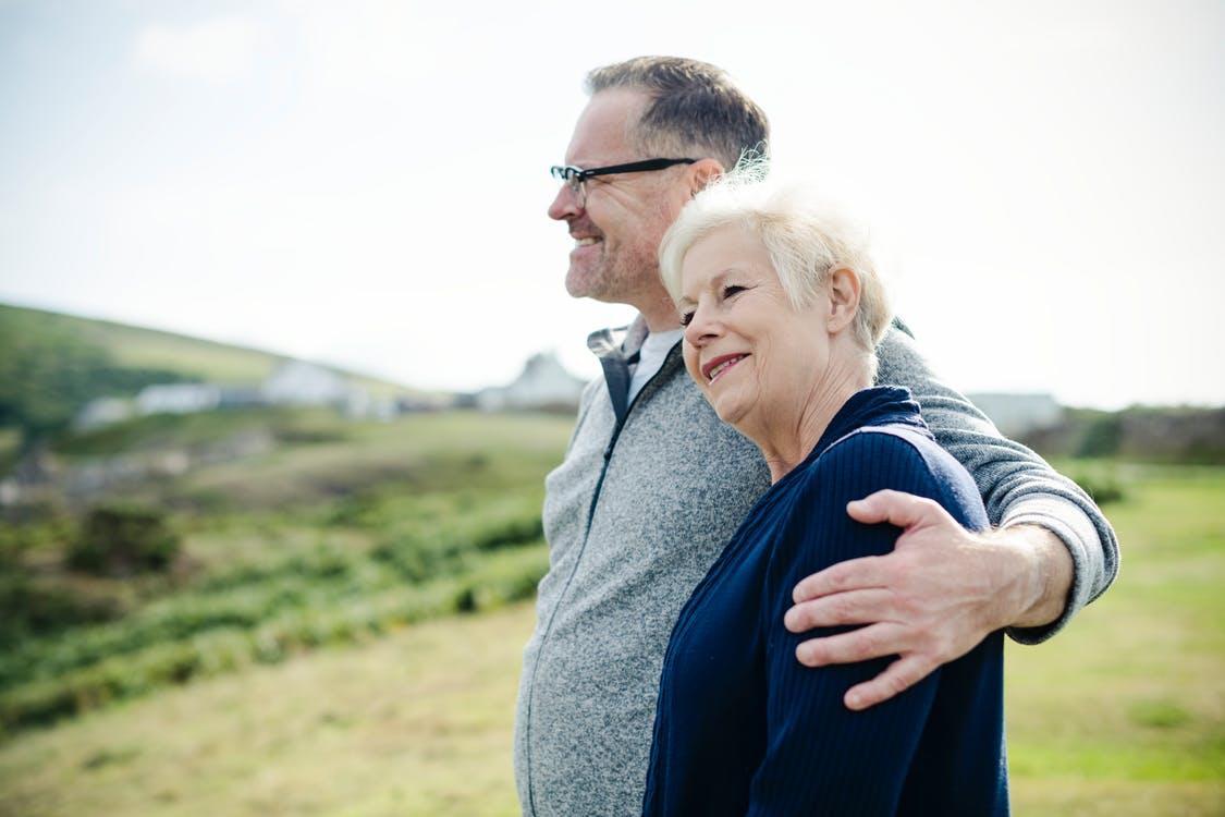 Smiling Man Holding Woman's Left Shoulder