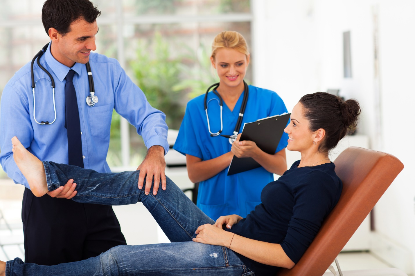 A doctor talking to a patient  Description automatically generated with low confidence